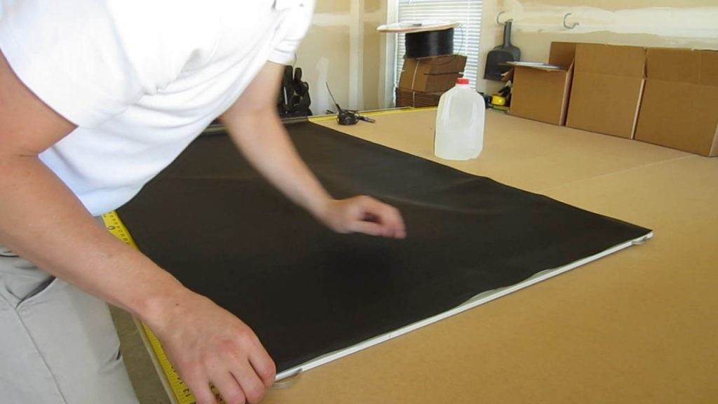 Solar Screen Assembly lay screen on frame